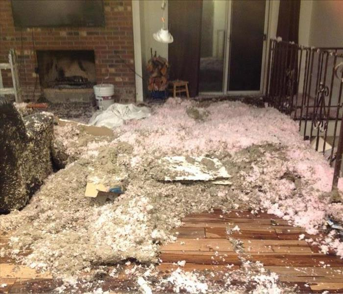 Insulation everywhere after water damage hit a Lakewood home.
