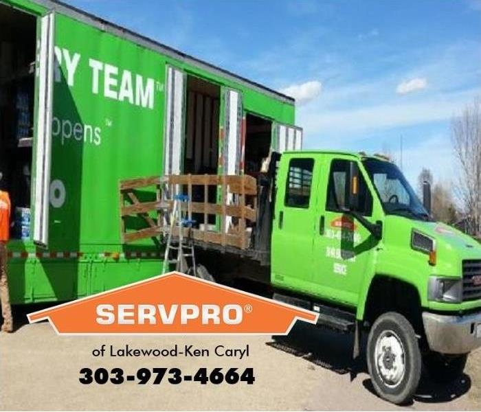SERVPRO trucks are shown loading fire restoration equipment onto a truck.