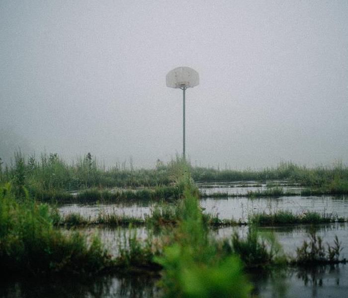 flooding surrounding a basketball hoop